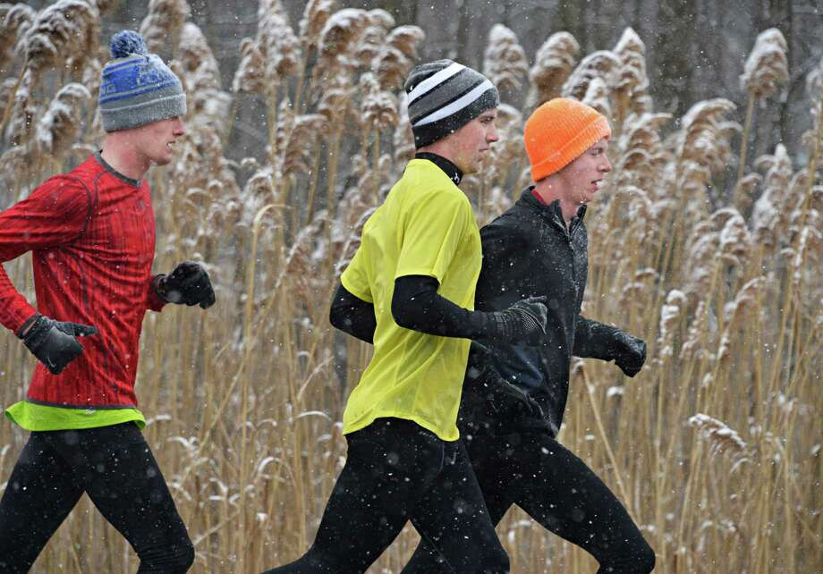 Siena cross country teammates, from left, Tom Higgins, Taylor Davis and Nick Grudev get in a run along Loudon Road in Colonie before the heavy snows begin to fall Friday Feb. 8, 2013.  (John Carl D'Annibale / Times Union) Photo: John Carl D'Annibale / 00021096A