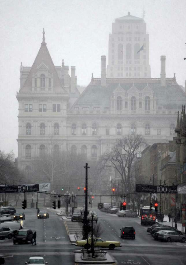 Snow causes a mist over the state Capitol this morning Feb. 8, 2013, as a forecasted storm approaches Albany, N.Y.   (Skip Dickstein/Times Union) Photo: SKIP DICKSTEIN