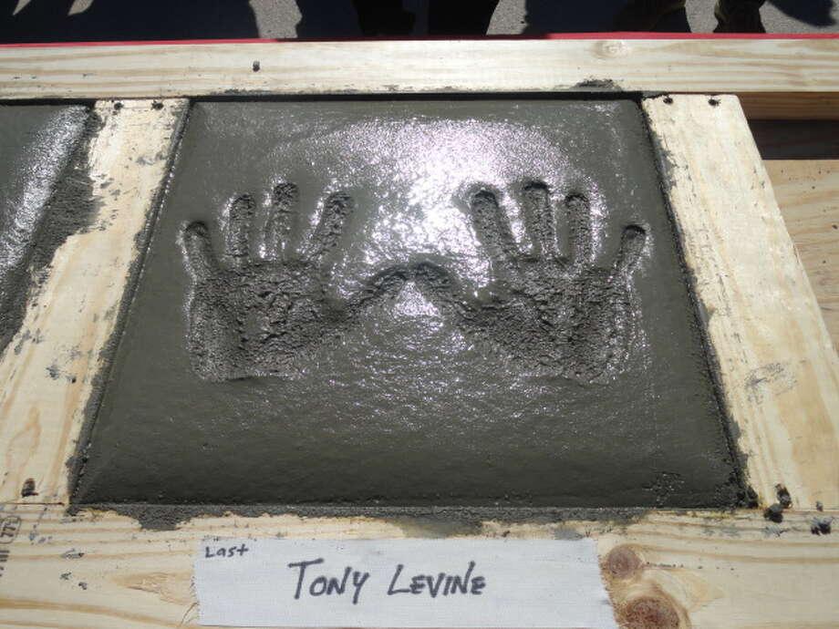 Concrete handprint of UH football coach Tony Levine.