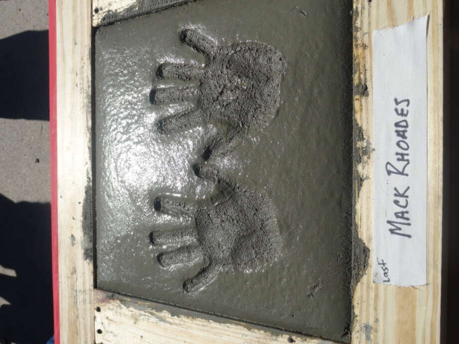 Concrete handprint of UH vice president of intercollegiate athletics Mack Rhoades.
