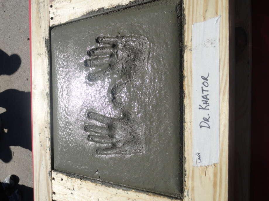 Concrete handprint of UH president Dr. Renu Khator.