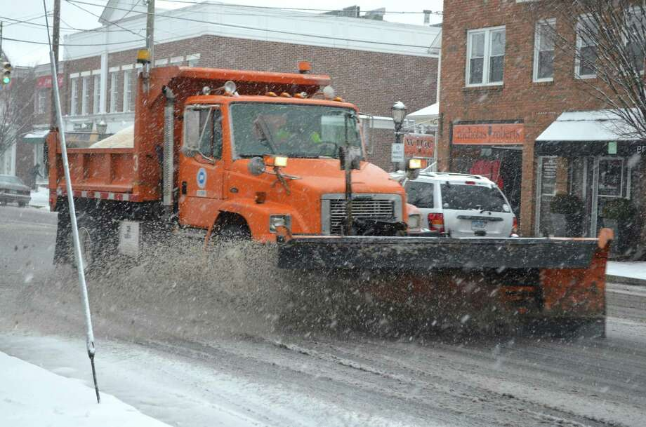 A plow takes on the snow on Post Road in Darien Friday morning. Megan Spicer / Staff photo  Feb. 8, 2013 Photo: Contributed Photo