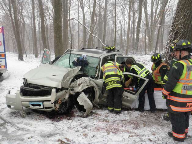 This morning at approximately 10:00 AM, the Westport Fire Department, Westport EMS and State police responded to a one vehicle accident with reported injuries on the Merritt Parkway between exits 42 and 44. Upon arrival units found a Ford Escape SUV that had struck a tree causing severe damage and air bag deployment. Photo: Contributed Photo, Westport Fire Department / Connecticut Post Contributed