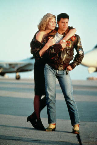 The odd couple of ''Top Gun'': Pete ''Maverick'' Mitchell (Tom Cruise) and astrophysicist girlfriend Charlotte ''Charlie'' Blackwood (KellyMcGillis). The only thing missing from this photo is Mav's motorcycle. Photo: Paramount Pictures, Getty Images  / 2012 Getty Images