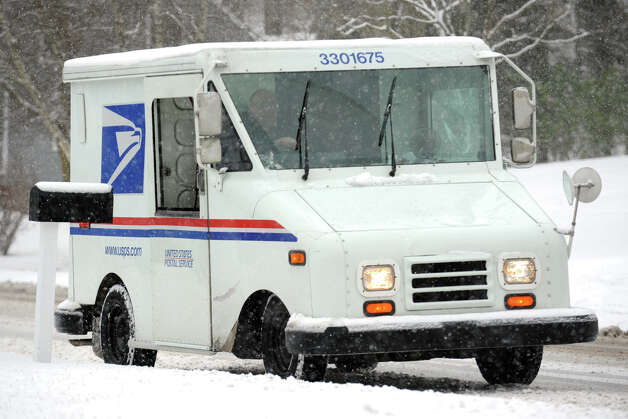 A mailman drives his route as snow falls along Cutsprings Rd., in Stratford, Conn., Feb. 8th, 2013. Photo: Ned Gerard / Connecticut Post