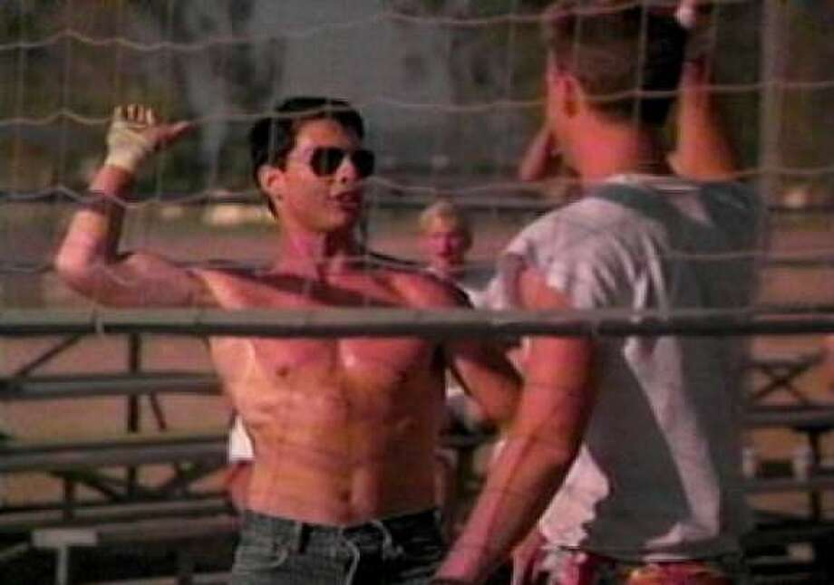 The famous ''Top Gun'' windmill high five has become an iconic gesture, most recently appearing in the last season of ''30 Rock.'' (The shirtless volleyball scene - set to Kenny Loggins' ''Playing with the Boys'' - has also become great fodder for parody).
