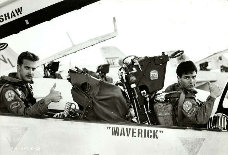 "More thumbs-up from dudes, this time from fellow pilot ""Goose"" (Anthony Edwards, left) and ""Mav"" (Tom Cruise, right). These two are tight, but things end badly. Photo: Ralph Nelson, Paramount Pictures"