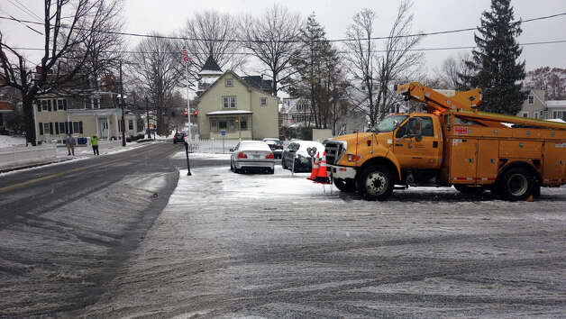 A Connecticut Light and Power truck waits for action on Amongerone Crossway as a blizzard moves into Greenwich, Conn., Feb. 8, 2013. Photo: Keelin Daly / Keelin Daly
