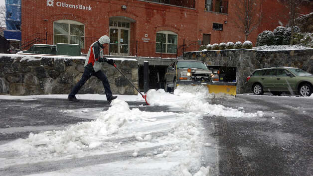 A man shovels the walkway along Amongerone Crossway as a blizzard moves into Greenwich, Conn., Feb. 8, 2013. Photo: Keelin Daly / Keelin Daly