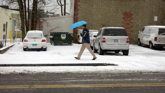A man walks along Amongerone Crossway as a blizzard moves into Greenwich, Conn., Feb. 8, 2013. Photo: Keelin Daly / Keelin Daly