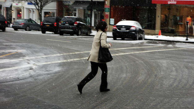 Greenwich Avenue starts to fade to white as a blizzard moves into Greenwich, Conn., Feb. 8, 2013. Photo: Keelin Daly / Keelin Daly