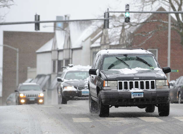 Vehicles navigate a slushy East Putnam Avenue during the snowstorm that hit Greenwich, Conn., Friday, Feb. 8, 2013. Photo: Bob Luckey / Greenwich Time