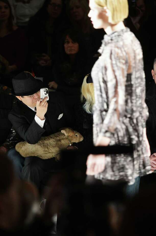 Taxidermist Takeshi Yamada is holding a stuffed rabbit that has been equipped with what appears to be webbed feet, front row at New York Fashion Week.   Photo: Michael Loccisano, Getty Images For AMC / 2013 Getty Images