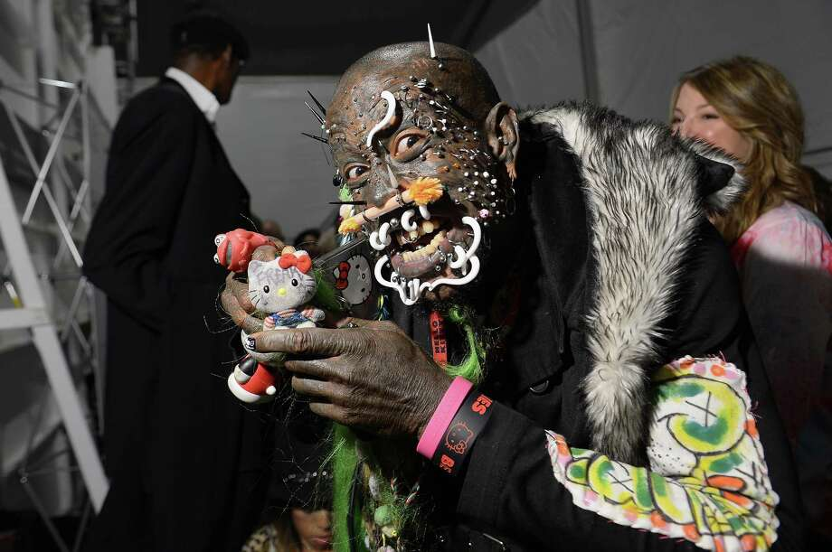 Marcus the Creature's go-to fashion accessory? Hello Kitty, of course. And let's not forget the orange nose piercing.  Photo: Michael Loccisano, Getty Images For AMC / 2013 Getty Images