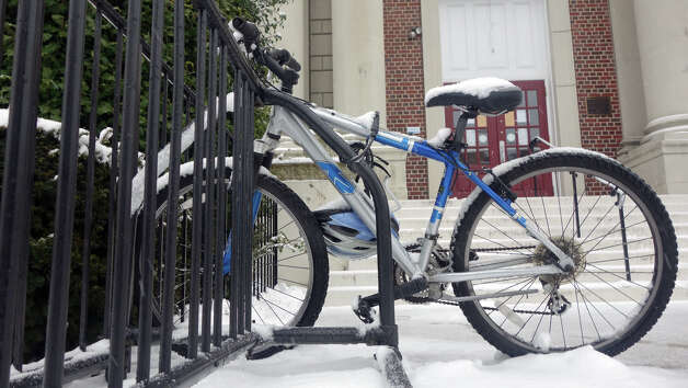 A bike is abandoned on East Putnam Avenue as a blizzard moves into Greenwich, Conn., Feb. 8, 2013. Photo: Keelin Daly / Keelin Daly