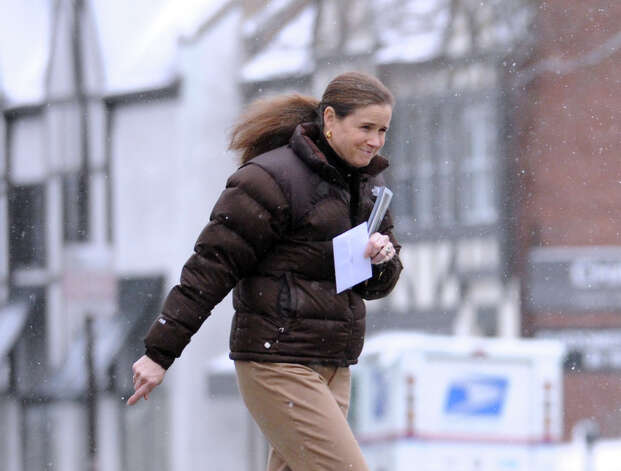 A woman crosses East Putnam Avenue during the snowstorm that hit Greenwich, Conn., Friday, Feb. 8, 2013. Photo: Bob Luckey / Greenwich Time