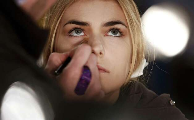 A model prepares backstage at the Sally Lapointe during the Mercedes-Benz Fashion Week at Pier 57 on February 8, 2013 in New York City. Photo: Brian Ach, Getty Images / 2013 Getty Images