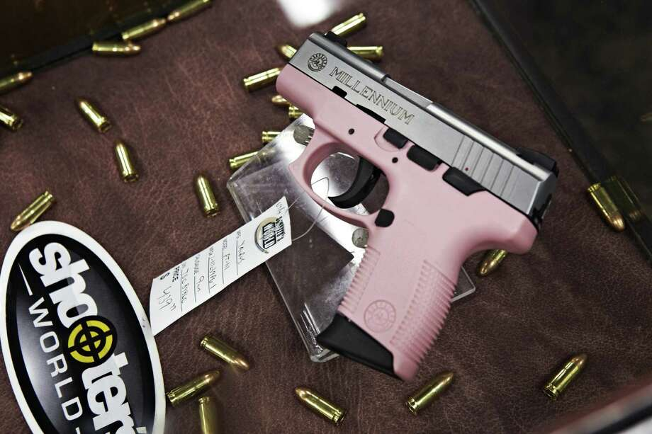 A pink semi-automatic handgun on display at the Gun Showroom in Phoenix, Arizona. Photo: Contributed Photo / Stamford Advocate Contributed