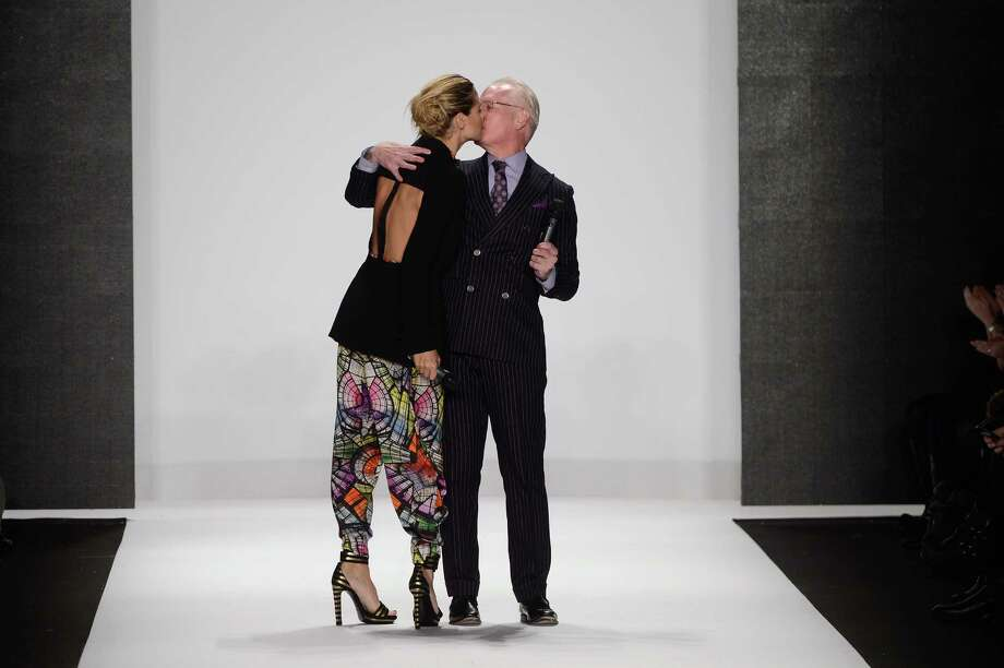 Heidi Klum and Tim Gunn speak on the runway at the Project Runway Fall 2013 fashion show during Mercedes-Benz Fashion Week at The Theatre at Lincoln Center on February 8, 2013 in New York City.  (Photo by Frazer Harrison/Getty Images for Mercedes-Benz Fashion Week) Photo: Frazer Harrison, (Credit Too Long, See Caption) / 2013 Getty Images