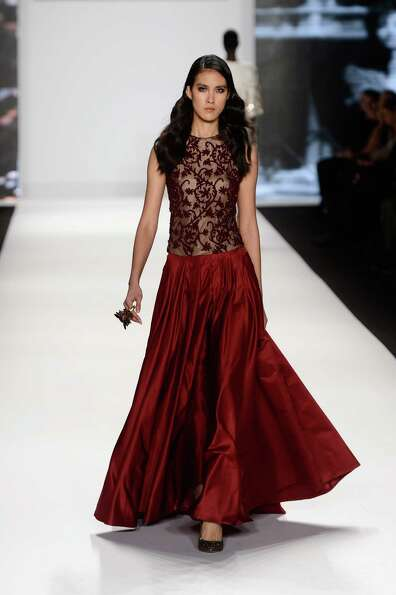 A model walks the runway at the Project Runway Fall 2013 fashion show during Mercedes-Benz Fashion