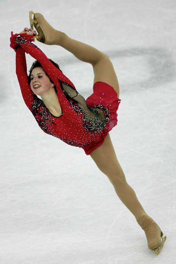 Bronze medalist Russia's Irina Slutskaya skates during the Women's Free Skate  in Turin, Italy during the Turin 2006 Winter Olympic Games on Thursday, Feb. 23, 2006. (AP Photo/Mark Baker) Photo: MARK BAKER / AP