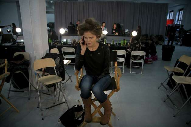 Models are seen backstage before the Kate Spade New York fall 2013 presentation during Mercedes-Benz Fashion Week on February 8, 2013 in New York City. Photo: Allison Joyce, Getty Images / 2013 Getty Images
