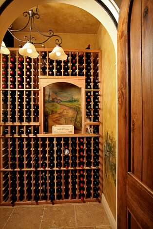 Climate-controlled wine cellar of 1403 McGilvra Boulevard E., in Washington Park. The 6,970-square-foot neoclassical mansion, built in 2006, has six bedrooms, 5.75 bathrooms, French doors, vaulted ceilings, a family room, a den, a theater, an exercise room, a sauna, an elevator, central air conditioning and vacuum, multiple balconies, a rooftop terrace, a patio with a fireplace, and views of Mount Rainier and Lake Washington on a 7,200-square-foot lot. It's listed for $3.2 million. Photo: Courtesy Mary Love Mattox/Windermere Real Estate
