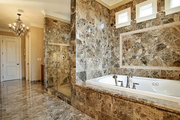 Bathroom of 1403 McGilvra Boulevard E., in Washington Park. The 6,970-square-foot neoclassical mansion, built in 2006, has six bedrooms, 5.75 bathrooms, French doors, vaulted ceilings, a family room, a den, a theater, an exercise room, a sauna, an elevator, a climate-controlled wine cellar, central air conditioning and vacuum, multiple balconies, a rooftop terrace, a patio with a fireplace, and views of Mount Rainier and Lake Washington on a 7,200-square-foot lot. It's listed for $3.2 million. Photo: Courtesy Mary Love Mattox/Windermere Real Estate