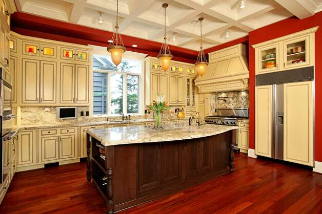 Kitchen of 1403 McGilvra Boulevard E., in Washington Park. The 6,970-square-foot neoclassical mansion, built in 2006, has six bedrooms, 5.75 bathrooms, French doors, vaulted ceilings, a family room, a den, a theater, an exercise room, a sauna, an elevator, a climate-controlled wine cellar, central air conditioning and vacuum, multiple balconies, a rooftop terrace, a patio with a fireplace, and views of Mount Rainier and Lake Washington on a 7,200-square-foot lot. It's listed for $3.2 million. Photo: Courtesy Mary Love Mattox/Windermere Real Estate