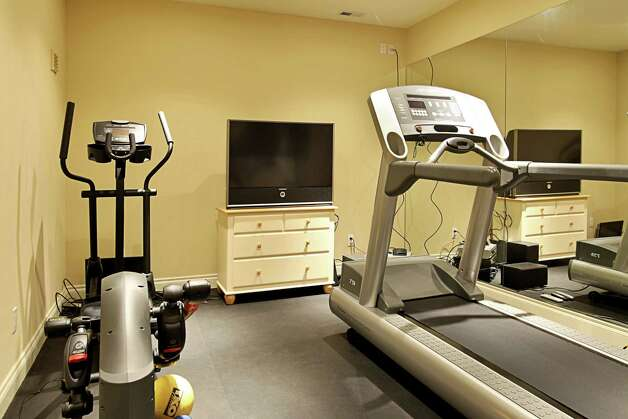 Exercise room of 1403 McGilvra Boulevard E., in Washington Park. The 6,970-square-foot neoclassical mansion, built in 2006, has six bedrooms, 5.75 bathrooms, French doors, vaulted ceilings, a family room, a den, a theater, a sauna, an elevator, a climate-controlled wine cellar, central air conditioning and vacuum, multiple balconies, a rooftop terrace, a patio with a fireplace, and views of Mount Rainier and Lake Washington on a 7,200-square-foot lot. It's listed for $3.2 million. Photo: Courtesy Mary Love Mattox/Windermere Real Estate