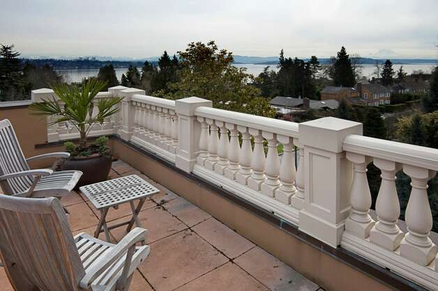 Rooftop terrace of 1403 McGilvra Boulevard E., in Washington Park. The 6,970-square-foot neoclassical mansion, built in 2006, has six bedrooms, 5.75 bathrooms, French doors, vaulted ceilings, a family room, a den, a theater, an exercise room, a sauna, an elevator, a climate-controlled wine cellar, central air conditioning and vacuum, multiple balconies, a patio with a fireplace, and views of Mount Rainier and Lake Washington on a 7,200-square-foot lot. It's listed for $3.2 million. Photo: Courtesy Mary Love Mattox/Windermere Real Estate