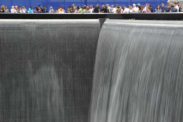 Friends and family of victims gather at the North Pool of the 9/11 Memorial during the 10th anniversary ceremonies of September 11 at the World Trade Center site, September 11, 2011 in New York City. Photo: Pool, Getty