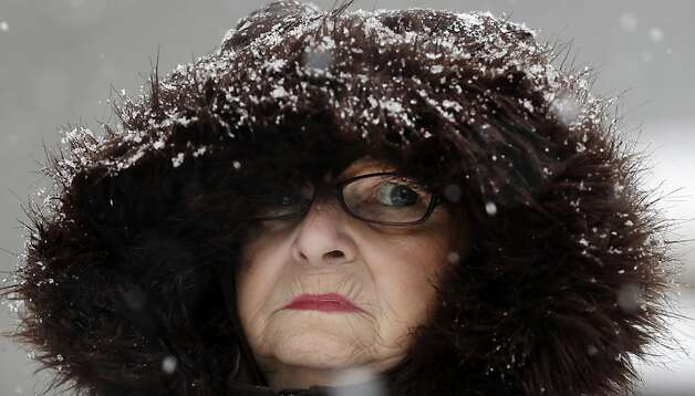 Mary Ann Bova walks along a slippery snow-covered sidewalk during a winter storm in Buffalo, N.Y., Friday, Feb. 8, 2013. In some upstate areas, snow fell early Friday morning and was expected to increase throughout the day, with the heaviest accumulations expected in eastern New York on Friday night. Photo: David Duprey, Associated Press