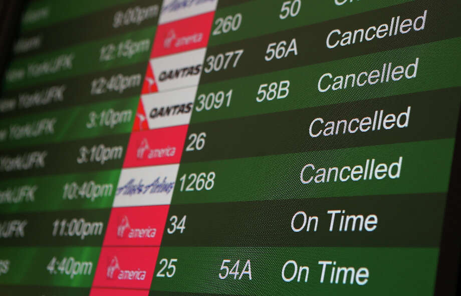 Canceled flights due to weather are displayed on a departure monitor at San Francisco International Airport on February 8, 2013 in San Francisco, California.  Thousands of flights to the East Coast were canceled as a potentially historic blizzard is set to dump up to three feet of snow in the Northeast from New York City to Boston. Photo: Justin Sullivan, Getty Images / 2013 Getty Images