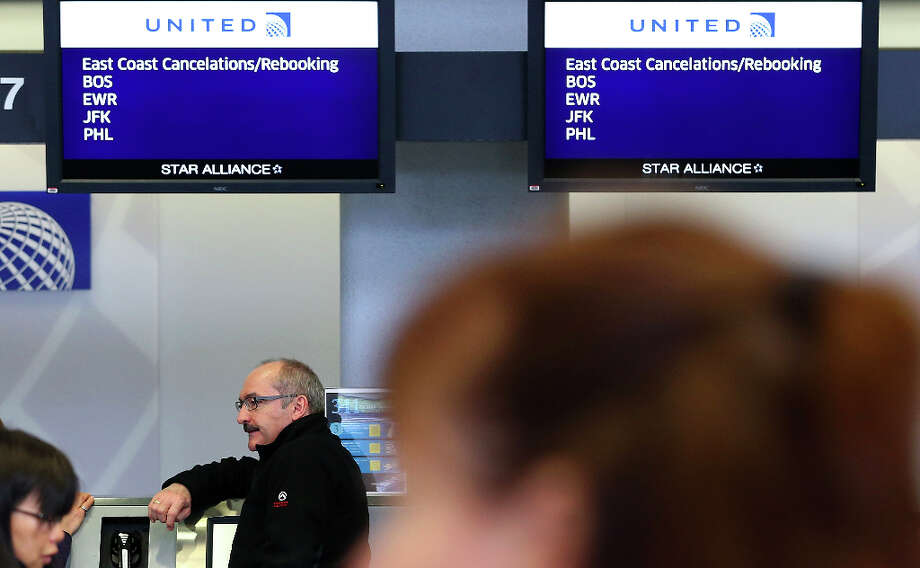 A United Airlines customer lines up to rebook a flight that was canceled due to weather at San Francisco International Airport on February 8, 2013 in San Francisco, California.  Thousands of flights to the East Coast were canceled as a potentially historic blizzard is set to dump up to three feet of snow in the Northeast from New York City to Boston. Photo: Justin Sullivan, Getty Images / 2013 Getty Images