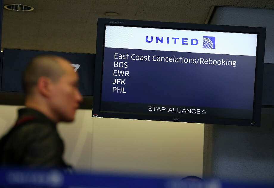 A United Airlines customer lines up to rebook a flight that was canceled due to weather on February 8, 2013 in San Francisco, California.  Thousands of flights to the East Coast were canceled as a potentially historic blizzard is set to dump up to three feet of snow in the Northeast from New York City to Boston. Photo: Justin Sullivan, Getty Images / 2013 Getty Images