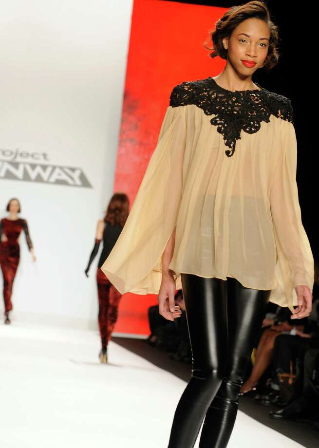 "Fashion by the finalists of  ""The Project Runway"" fashion competition series is modeled during Fashion Week, Friday Feb. 8, 2013, in New York. (AP Photo/Louis Lanzano) Photo: Louis Lanzano, Associated Press / FR77522 AP"