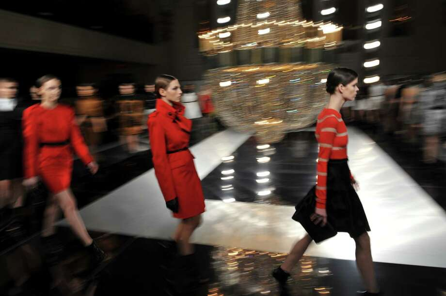 Models wears designs by Jason Wu during the Mercedes-Benz Fashion Week Fall 2013 collections on February 8, 2013 in New York. AFP PHOTO/Stan HONDASTAN HONDA/AFP/Getty Images Photo: STAN HONDA, AFP/Getty Images / AFP