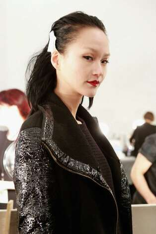 A model prepares backstage at the Carmen Marc Valvo Fall 2013 fashion show during Mercedes-Benz Fashion Week at The Stage at Lincoln Center on February 8, 2013 in New York City.  (Photo by Cindy Ord/Getty Images for Carmen Marc Valvo) Photo: Cindy Ord, (Credit Too Long, See Caption) / 2013 Getty Images