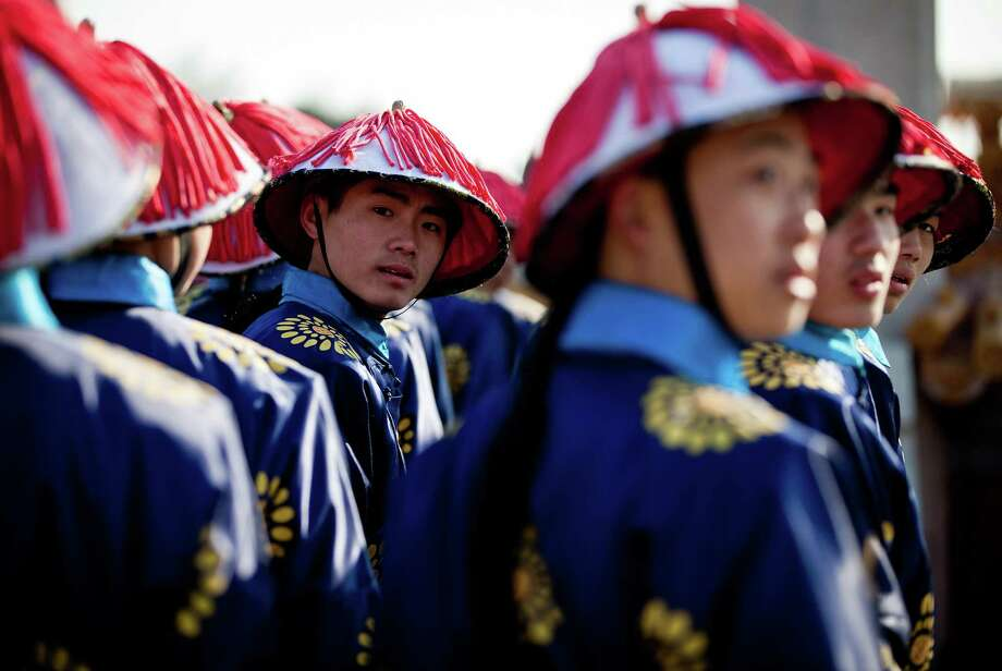 Chinese actors dressed as Qing Dynasty servants take part in a rehearsal of ancient Qing Dynasty ceremony for the upcoming Chinese New Year at Ditan Park in Beijing, Friday, Feb. 8, 2013. Chinese will celebrate the Lunar New Year on Feb. 10 this year which marks the Year of Snake. Photo: Andy Wong, AP / AP