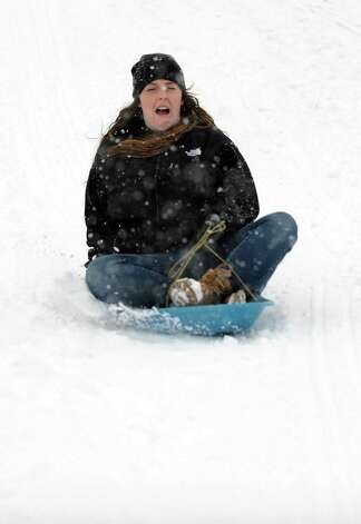 Casey Morley sleds in Cummings Park during Friday's blizzard in Stamford, Conn., on February 8, 2013. Photo: Lindsay Perry / Stamford Advocate