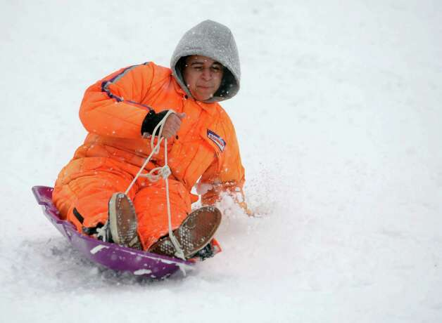 Jonathan Miranda, 17, sleds in Cummings Park during Friday's blizzard in Stamford, Conn., on February 8, 2013. Photo: Lindsay Perry / Stamford Advocate