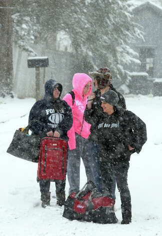Patty Mele, of Milford, and her daughters Christine and Maria, left, and friend Matthew Gray wait for a ride from friend Alice Grant to get to Mohegan Sun to see Bon Jovi in concert in Milford Conn. on Friday February 8, 2013. The group was on its way earlier but they had an accident because of the snow while getting onto I95 in Milford. Their friend Alice was half way to the concert when she had to come back to get them. Photo: Christian Abraham / Connecticut Post