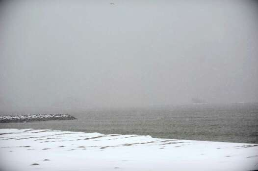 Snow falls at Cummings Beach during Friday's blizzard in Stamford, Conn., on February 8, 2013. Photo: Lindsay Perry / Stamford Advocate