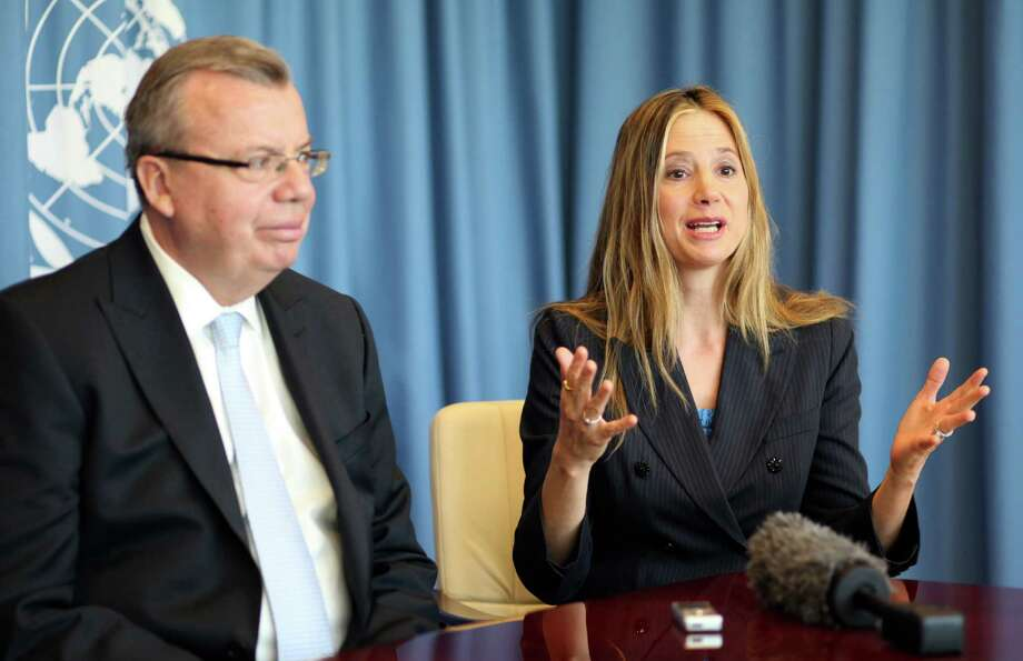 "UNODC's Executive Director Yury Fedotv, left, and US actress Mira Sorvino, a UN Goodwill Ambassador to combat human trafficking for the United Nations Office on Drugs and Crime, UNODC, attend an interview by the Associated Press at the United Nations in Vienna, Austria, Friday, Feb. 8, 2013. ""I love acting and that is my job right now,"" Sorvino says. At the same time, she describes her advocacy against human trafficking and modern-day slavery as ""my calling,"" and so important that ""in a decade or so, I wouldn't mind just switching to a career in humanitarian causes."" (AP Photo/Alexander Mueller) Photo: Alexander Mueller"