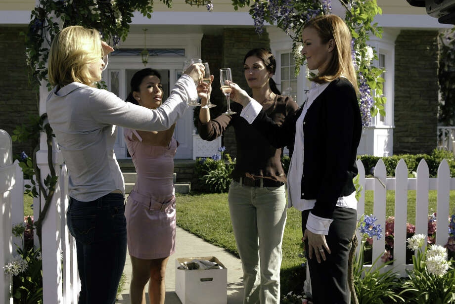 This undated file photo from ABC, shows Felicity Huffman, Eva Longoria, Teri Hatcher and Marcia Cross, from left, toast one another in a scene from ABC's Desperate Housewives. Photo: PETER STONE, AP / ABC, INC.