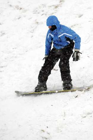 Jake Caruso, 14, snowboards in Cummings Park during Friday's blizzard in Stamford, Conn., on February 8, 2013. Photo: Lindsay Perry / Stamford Advocate