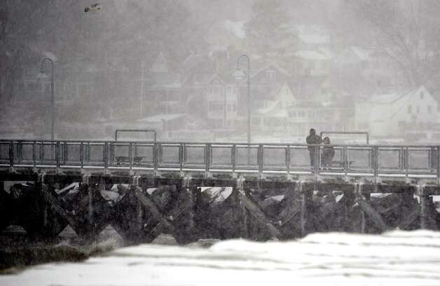 Pedestrians brave the snow at Cummings Beach during Friday's blizzard in Stamford, Conn., on February 8, 2013. Photo: Lindsay Perry / Stamford Advocate