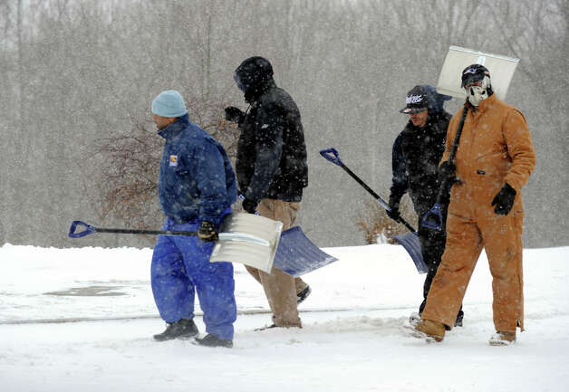 A maintenance crew prepares to shovel walkways on Western Connecticut State University's westside campus during Friday's snowstorm, Feb. 8, 2013. Photo: Carol Kaliff / The News-Times