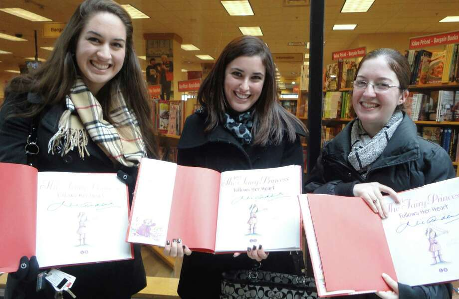 Fairfield University students, from left, Danielle Anctil of Litchfield, N.H.; Devan Conroy of Middletown, N.Y.,  and Jennifer Fiorillo, of Babylon, N.Y., were thrilled to meet singer-actress Julie Andrews and have her autograph copies of her new children's book Thursday at the Fairfield University Bookstore. No photos were allowed of Andrews unless approved by her publicity team and the bookstore/university staff.  FAIRFIELD CITIZEN, CT 2/7/13 Photo: Meg Barone / Fairfield Citizen freelance